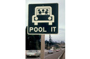 G2_395px-_pool_it__sign_north_of_vancouver__washington__was_a_reminder_that_the_gasoline_shortage_was_not_over_in_march__1974_and_sharing_rides_was_a_good_idea_03-1974